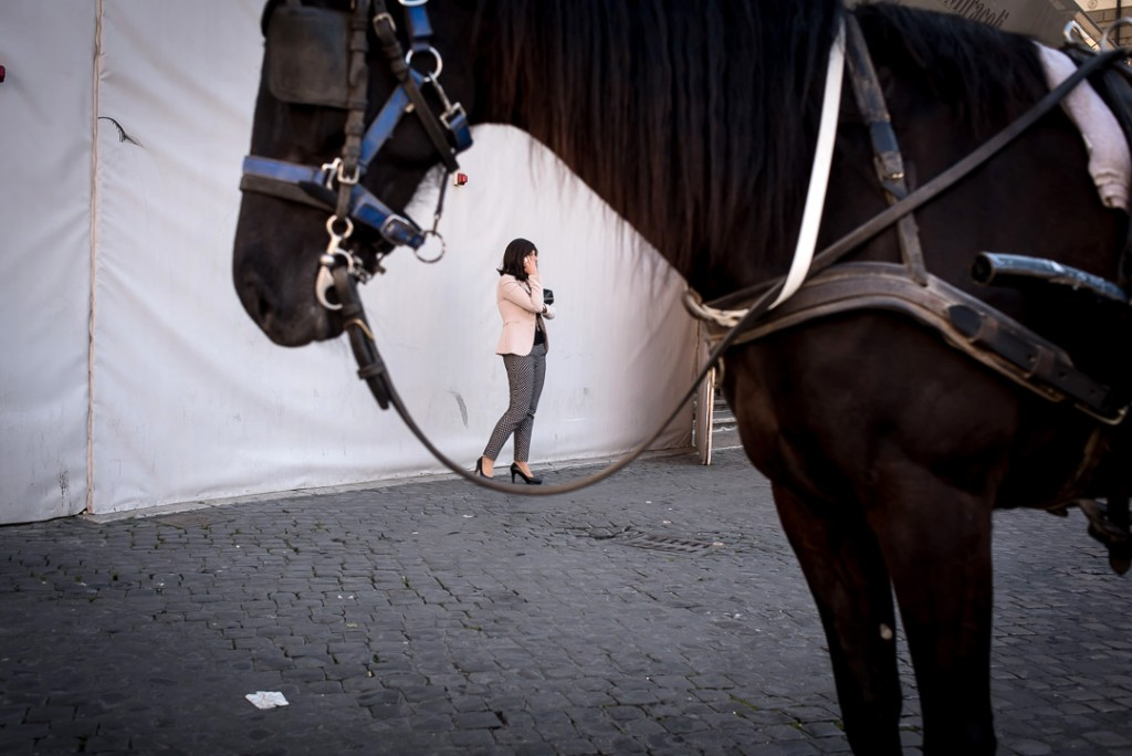 Woman balancing on horse reins-street photo Tim Fox