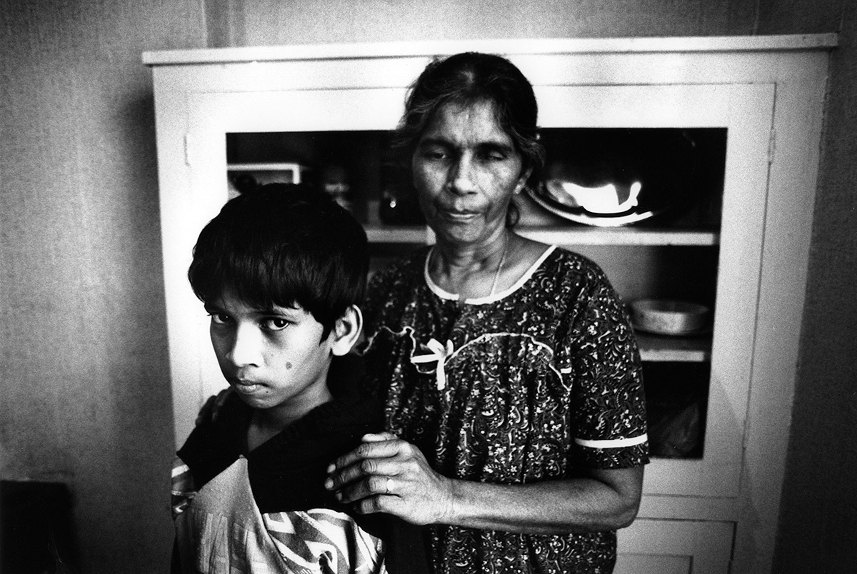 Tim Fox - London black and white Street Photograph- mother and son Sri Lankan refugees